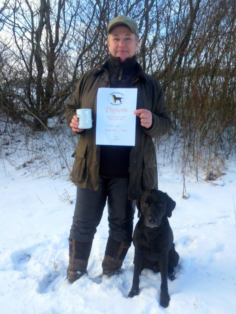 2UM2014 Ravensbank Floyd (Lewis) becomes WT1 in open class on unofficial Working Test 25 January 2015. Lewis is 2 years and 5 months old on the day. On the picture is Ms. Helga Thorstein, the owner and handler of Lewis. ©Anne Kjær Iversen